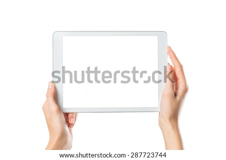 Closeup shot of woman hands holding digital tablet isolated on white background. Female hands holding a palmtop with white screen. Digital tablet with white display ready for your webpage or design. - stock photo