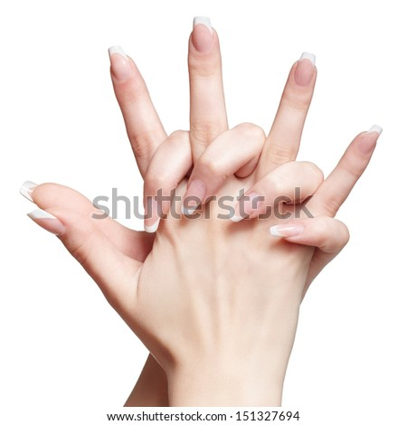 closeup shot of young woman's healthy hands with french manicure on white - stock photo