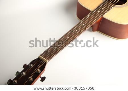 Closeup shot photo of the acoustic guitar. - stock photo
