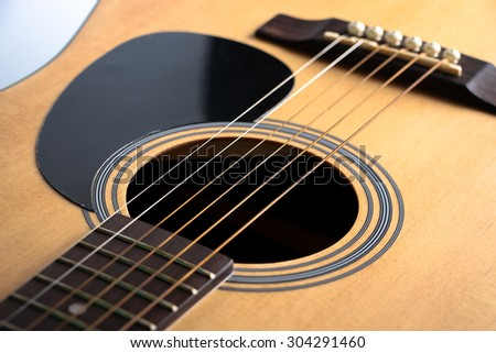 Closeup shot photo of the acoustic guitar.