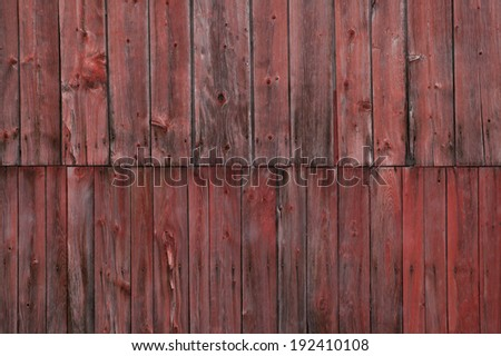 Closeup side of a weathered red barn, Stowe, Vermont, USA - stock photo