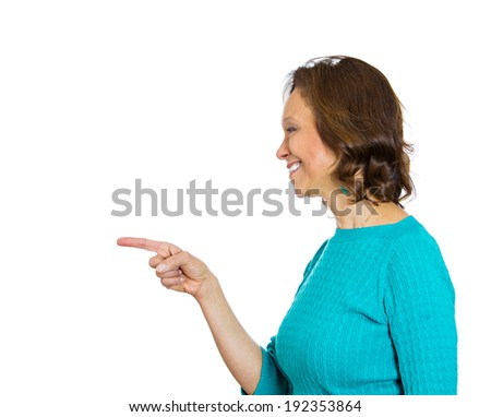 Closeup side portrait, headshot happy senior, mature woman pointing with one index finger gesture, isolated white background. Positive human emotion, facial expression, feelings, symbols, reaction - stock photo
