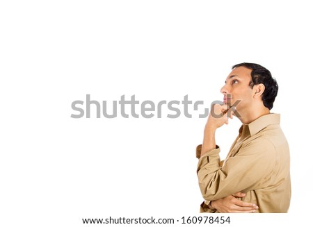 Closeup side profile portrait of handsome smiling young man, student, worker, daydreaming looking upwards with chin on fist, isolated on white background with copy space. Positive human emotions. - stock photo