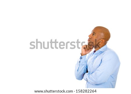 Closeup side profile portrait of handsome young guy thinking with fist under chin, isolated on white background with copy space. Human emotions and facial expressions - stock photo
