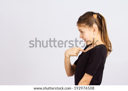 Closeup side profile portrait surprised, little girl getting unexpected attention from people, asking you talking to, mean me? pointing finger at herself isolated grey background. Facial expression - stock photo
