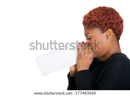 Closeup side profile preview portrait sick young woman student, worker, with germs cold, blowing nose with kleenex, looking miserable unwell very sick, isolated white background. Flu season, vaccine - stock photo