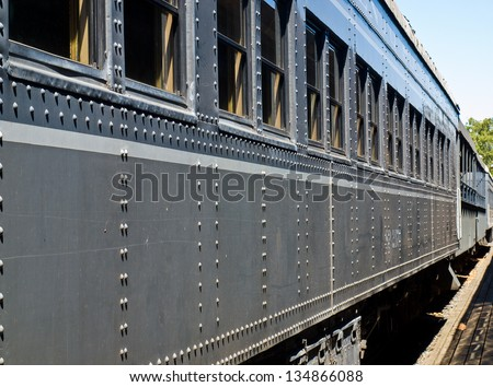 Closeup Side View of an Old-Fashioned Passenger Train - stock photo