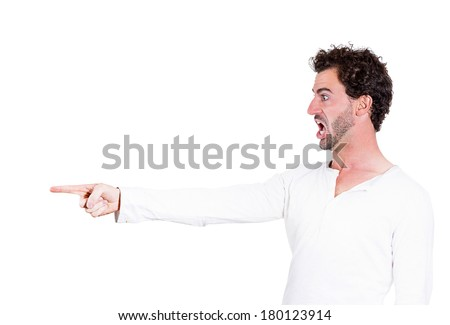 Closeup, side view portrait of handsome young man, unhappy guy, looking angry, agitated, screaming pointing with finger isolated on white background. Negative human emotion facial expression, reaction