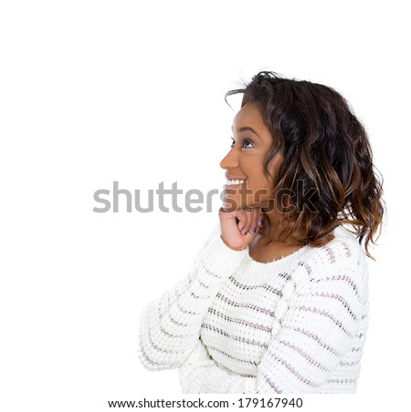 Closeup side view portrait of young business woman thinking, daydreaming deeply about something chin on hand looking up, isolated on white background. Human emotion facial expression feeling, reaction - stock photo