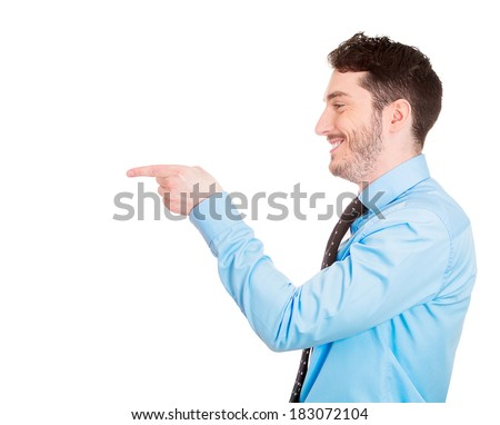 Closeup side view portrait of young man, laughing, pointing with finger at someone or something, isolated on white background. Positive human face expressions, emotions, feelings, attitude, approach - stock photo