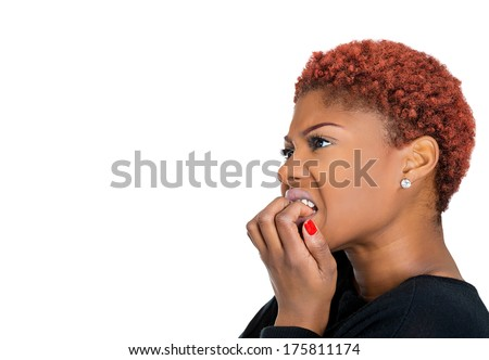 Closeup side view portrait of young unhappy, scared woman anxious female biting nails looking with craving, envy for something, worried, isolated on white background. Human face expressions, emotions - stock photo