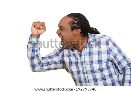 Closeup side view profile portrait angry man with fist, arms raised open mouth yelling, isolated white background. Negative emotion, facial expression feelings, reaction. Conflict problems, issues - stock photo