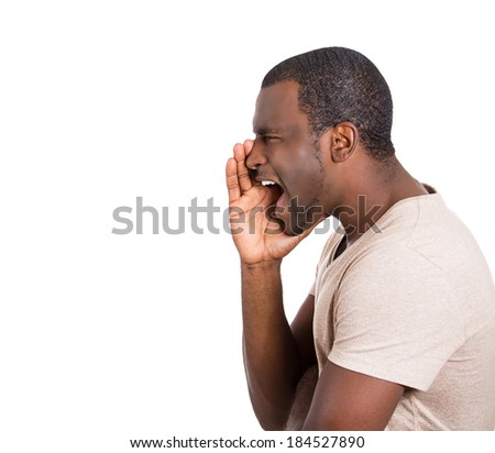 Closeup side view profile portrait, angry upset young man, worker, business employee, hand to open mouth yelling, isolated white background. Negative emotion facial expression feeling - stock photo