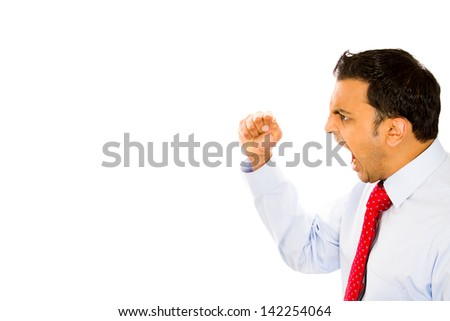 Closeup side view profile portrait, angry upset young man, worker, business employee, putting up fist in threatening fashion, isolated white background. Negative emotion facial expression feeling - stock photo
