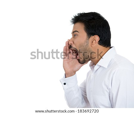 Closeup side view profile portrait, angry upset young man, worker, employee, business man, hand to mouth, open mouth yelling, isolated white background. Negative emotion facial expression emotion - stock photo