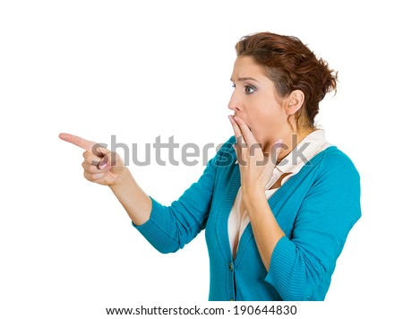 Closeup side view profile portrait, headshot very surprised shocked woman with big eyes, open mouth, pointing with finger, isolated white background. Unexpected human facial expression emotion feeling - stock photo