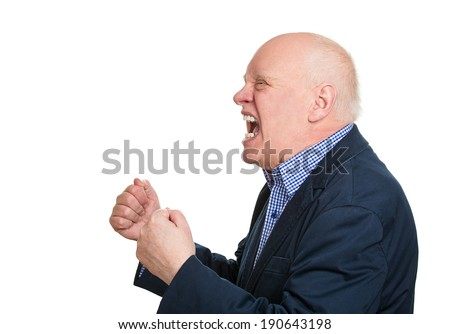 Closeup side view profile portrait, mad, upset, senior mature man, funny looking business man, fist in air, open mouth yelling, isolated white background. Negative emotion facial expression, reaction