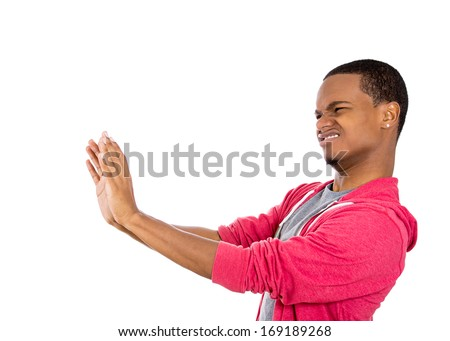 Closeup side view profile portrait of angry annoyed displeased young man raising hands up to say no stop right there, isolated on white background. Negative human emotion facial expression sign symbol - stock photo