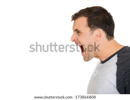 Closeup side view profile, portrait of angry upset, mad young man, worker, business employee, wide opened mouth, yelling, isolated on white background. Negative emotions, facial expressions, feelings - stock photo