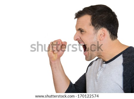 Closeup side view profile portrait of angry upset young man, worker, employee, business man fists in air, open mouth yelling, isolated on white background. Negative  emotion facial expression emotion - stock photo