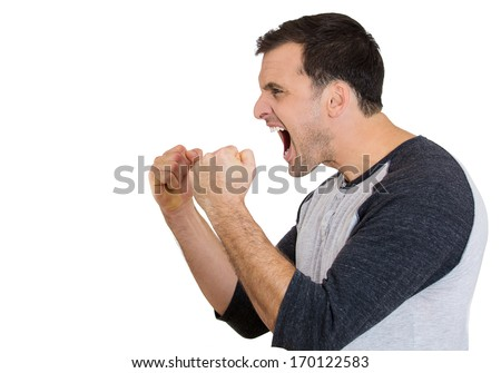 Closeup side view profile portrait of angry upset young man, worker, employee, business man fists in air, open mouth yelling, isolated on white background. Negative  emotion facial expression emotion