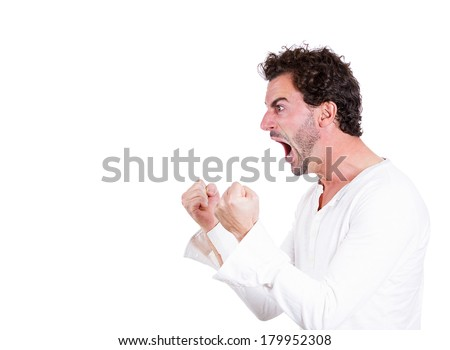Closeup side view profile portrait of angry upset young man, worker, employee, business man fists in air, open mouth yelling isolated on white background. Negative emotions, facial expression reaction - stock photo