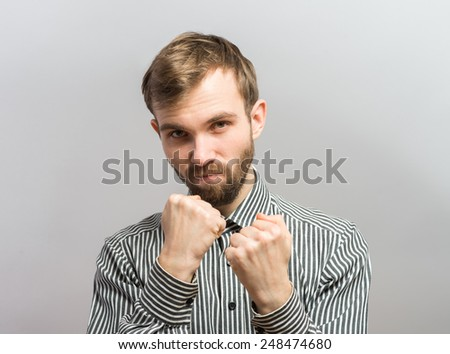 Closeup side view profile portrait of angry upset young man, worker, employee, business man fists in air, open mouth yelling, isolated. Negative  emotion facial expression emotion - stock photo
