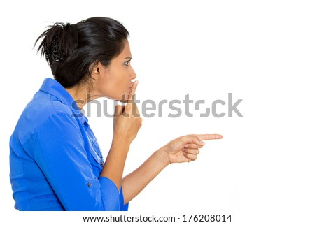 Closeup side view profile portrait of pretty young woman placing fingers on lips with shhh sign symbol, isolated on white background. Negative emotion facial expression feelings, body language - stock photo