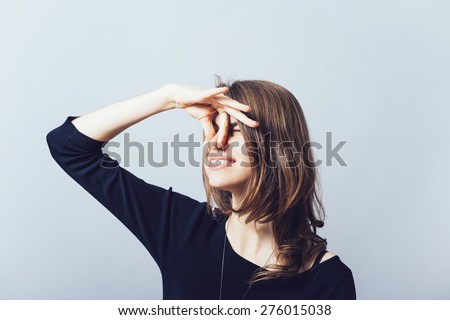 Closeup side view profile portrait young woman, disgust on face, pinches nose, something stinks, very bad smell, situation, isolated gray background. Negative human emotion facial expression feeling - stock photo