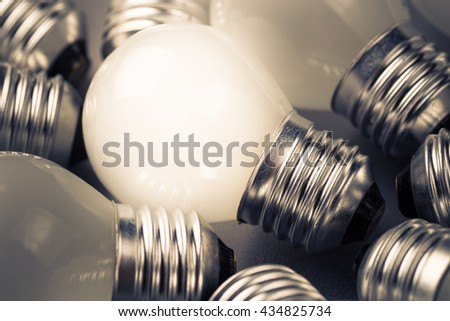 Closeup small light bulb in a group, find a niche or small business idea concept - stock photo