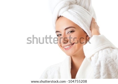 closeup smiling woman portrait wearing bathrobe over white background