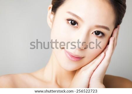 closeup smiling young beautiful woman face
