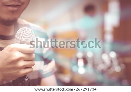 Closeup some part of singer singing with microphone - stock photo
