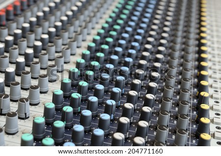 Closeup sound mixing control board - stock photo