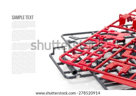 closeup sprue or injection moulding of toy - stock photo