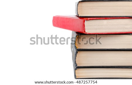 closeup stack of old books isolated on white background