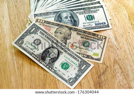 Closeup Stack of one and ten and one hundred dollar bills - stock photo