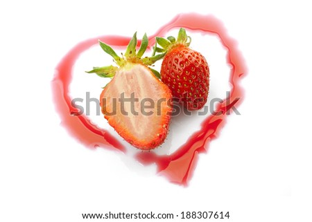 closeup studio photo of  two strawberries one half cut  inside shinny heart from strawberry syrup  isolated on white background