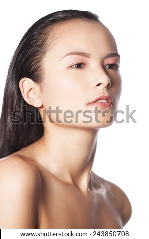 Closeup studio portrait of a beautiful young woman with perfect glowing skin  - stock photo
