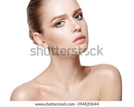 closeup studio portrait of beautiful model with professional makeup on white background. Perfect fresh skin. Blue eyes. Brunette hair. Isolated - stock photo
