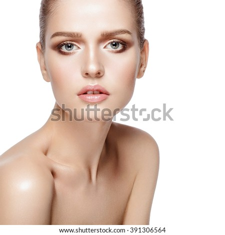 Closeup studio portrait of young attractive model with professional makeup on white background. Perfect skin. Blue eyes. Brunette hairdo. Isolated - stock photo