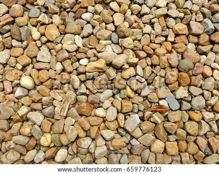 closeup surface detail of brown (beige) pebble stone texture background, rough floor or wall finishing for architecture and construction material