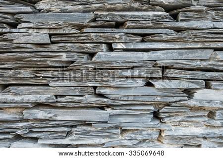 Closeup surface gray stone wall texture background - stock photo