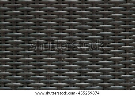 Closeup surface wood pattern at black painted wood weave chair texture background - stock photo