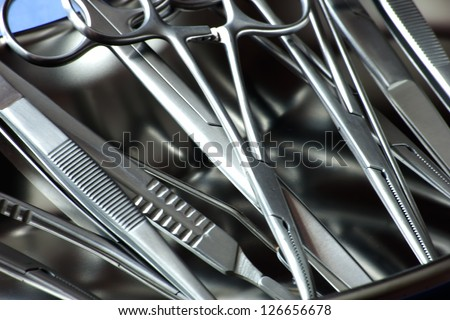 closeup surgical instruments in kidney tray - stock photo