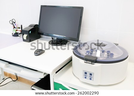 Closeup table medical centrifuge - stock photo