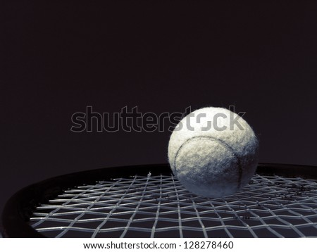 Closeup tennis racket and ball in monochrome. - stock photo