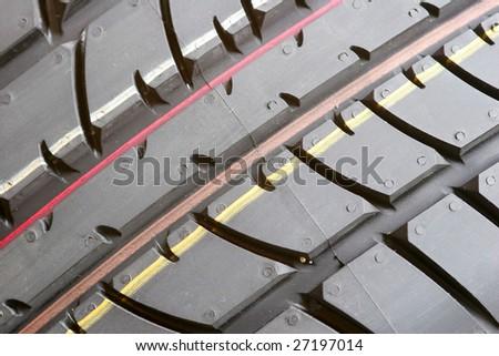 Closeup texture of a car tyre - stock photo