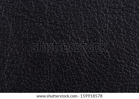 Closeup texture of black leather for background - stock photo