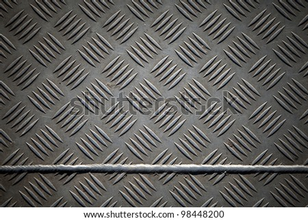 Closeup texture of diamond metal plate with joint - stock photo